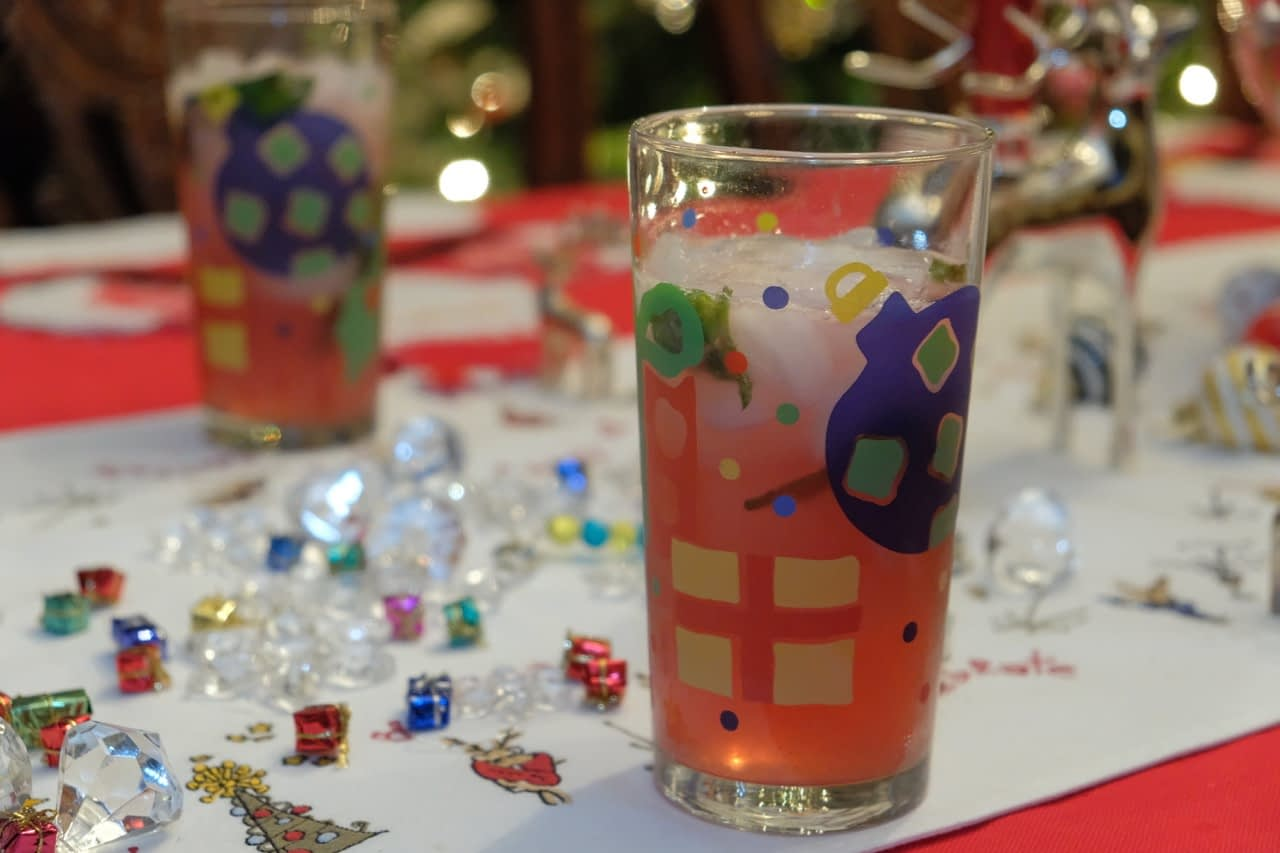 cranberry mojito in holiday themed glass on dinner table