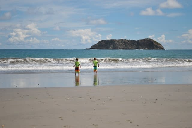 kids playing on the beach in manuel antonio