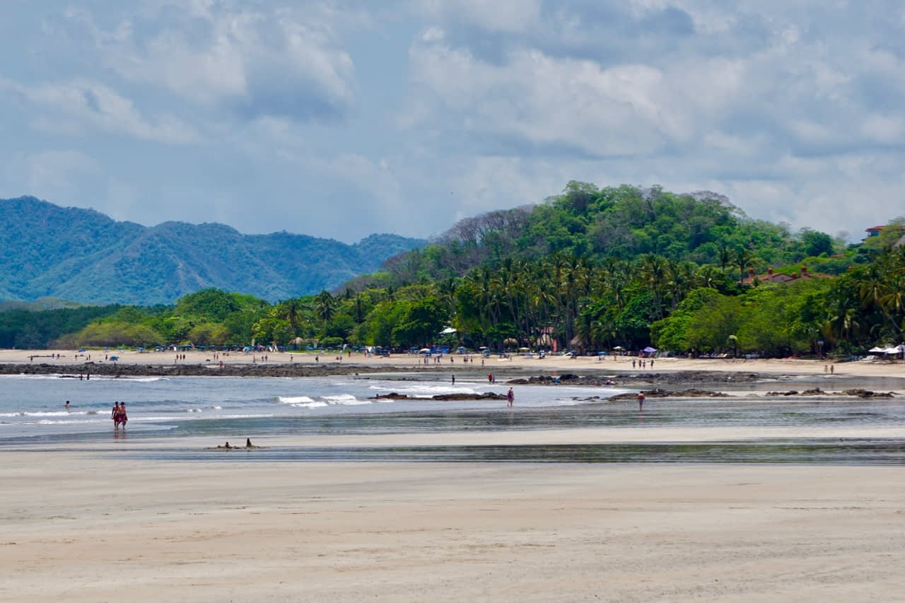 looking down the beach in tamarindo costa rica